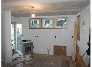 And here's the former utility room and washer/dryer area beside it.  Love these bitty windows for air and light.